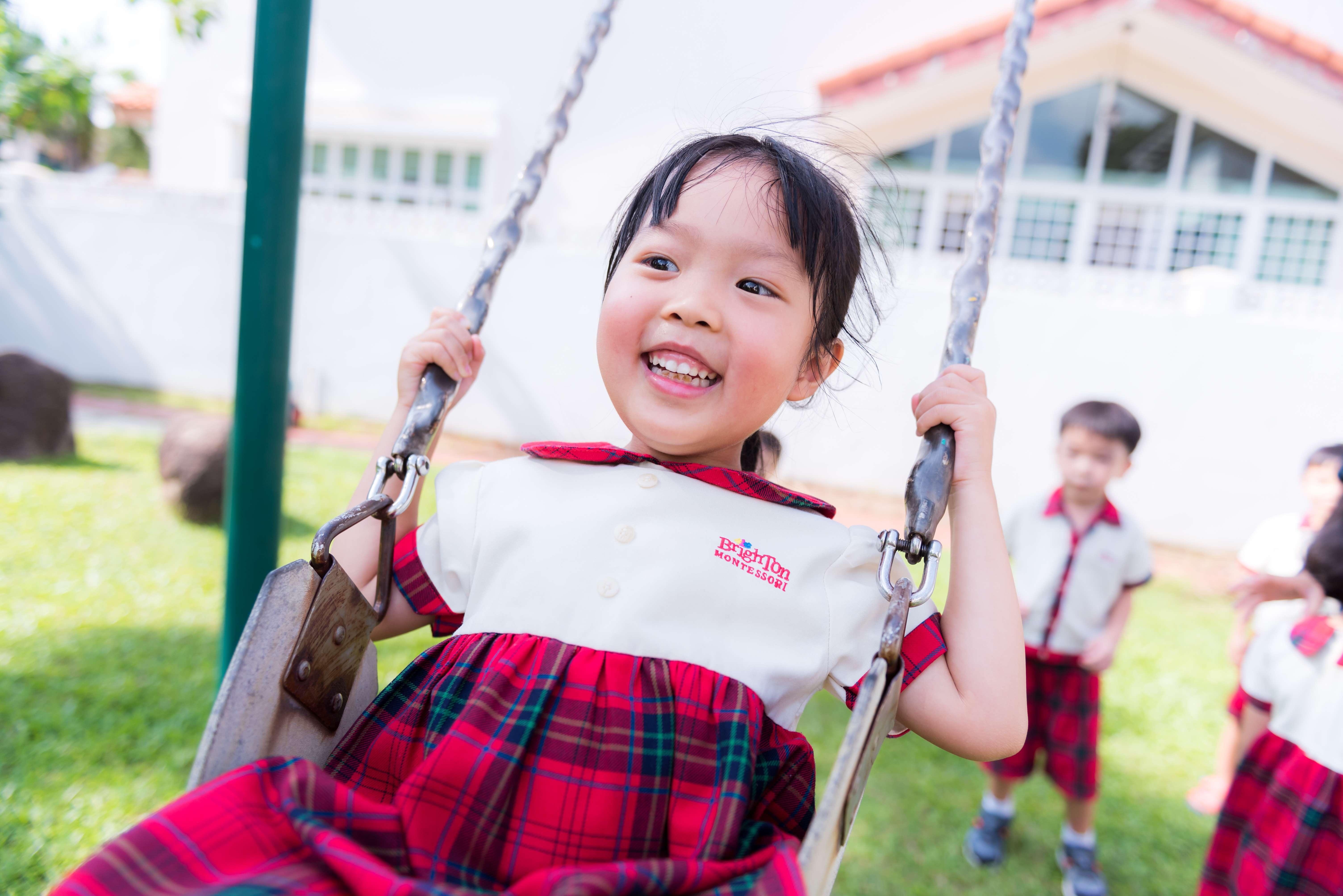 girl playing swing